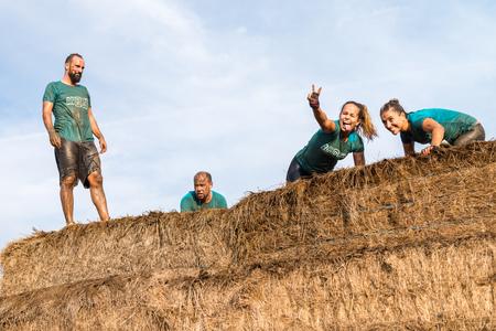 ESTARREJA, PORTUGAL - SEPTEMBER 23: Athletes overcoming the hay osbtacle at the Biorace on september 23, 2017 in Estarreja, Portugal.
