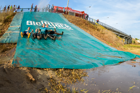 ESTARREJA, PORTUGAL - SEPTEMBER 23: Athletes sliding to mud and water at the Biorace on september 23, 2017 in Estarreja, Portugal.