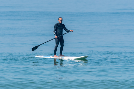 Stand up paddle surfer on the atlantic ocean. Stock Photo