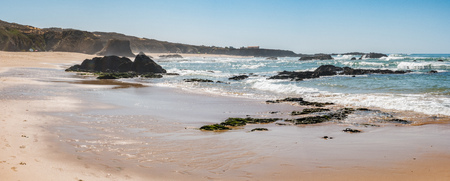 Beach with rocks in Almograve Alentejo Portugal Stock Photo