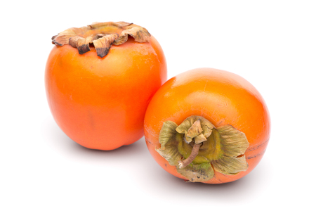 Persimmon fruits on white background.