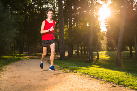 Athletic young man running in the nature. Healthy lifestyle Stock Photo