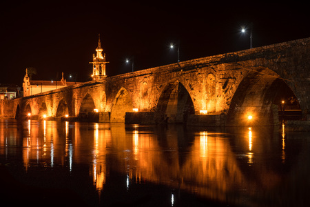 Night view of Roman bridge crossing the Rio Lima in Ponte de Lima. Camino de Santiago - Portugal.