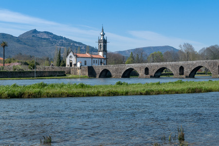 Santo Antonio da Torre Velha church and Roman bridge in Ponte de Lima town, Portugal. Stock Photo
