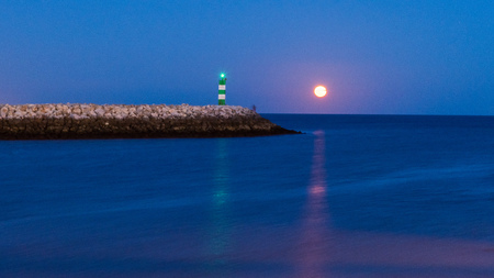 Moon rising in Lagos harbour, Algarve, Portugal.
