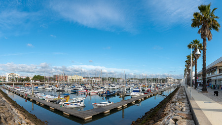 LAGOS, PORTUGAL - CIRCA MAY 2018: View of boats and yachts moored in the marina de Lagos, Lagos, Algarve, Portugal, Stock Photo - 103568142