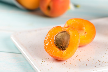 Delicious ripe apricots fruit on wooden background close up.