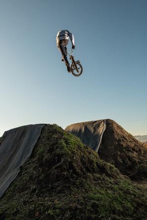 BMX Bike jump over a dirt trail on a dirt track. 스톡 콘텐츠