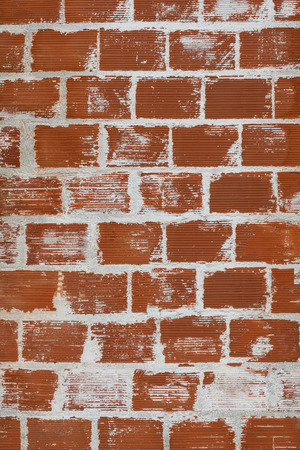 Weathered stained brick wall background
