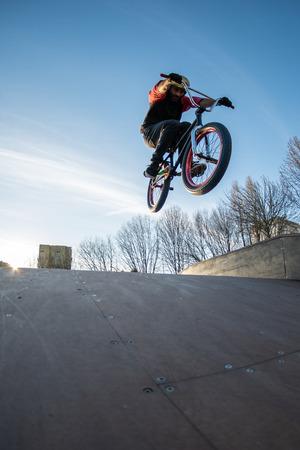 High BMX jump in a skate park.