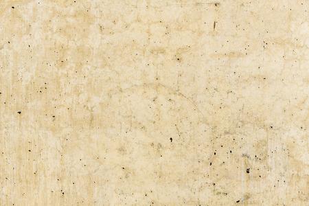 Rostige Steinbetonoberfläche in hellbrauner Farbe, detaillierte natürliche Textur. Standard-Bild