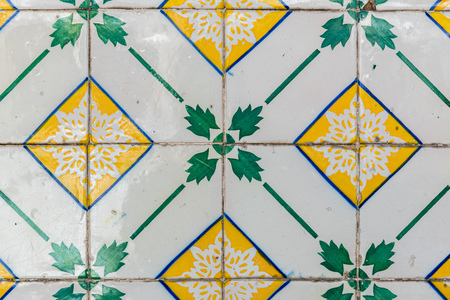 Closeup detail of old Portuguese glazed tiles. 免版税图像