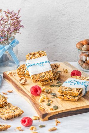 Organic homemade granola bars on rustic marble stone kitchen countertop. Stockfoto