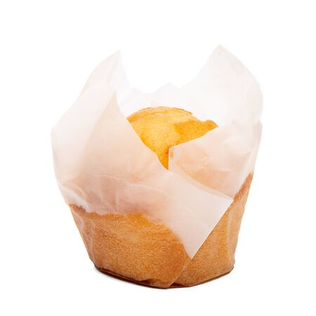 Closeup of a Magdalena Typical Spanish Plain Muffin. Sweet Food or Dessert. Fresh Baked Muffin Isolated on White Background in American Style. Irresistible Tasty Cake.