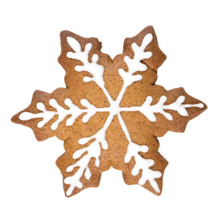 Gingerbread cookie in snowflake shape isolated on white background.