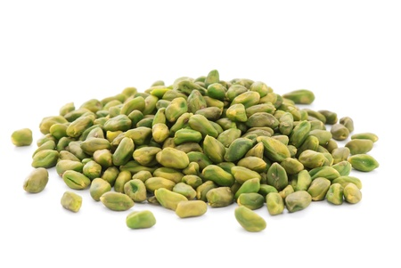 Close up shelled unsalted pistachios on white background photo