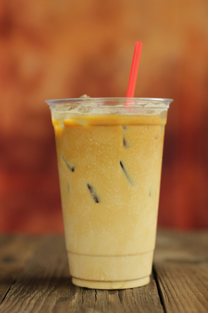 iced coffee: Iced coffee cafe latte on the wood