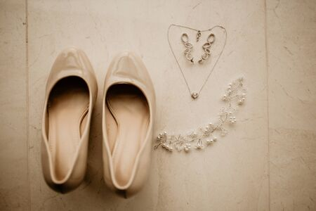 Bride's Accessories on wedding day. Chain looks like heart and shoes.
