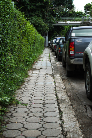 no way out: Chiang Mai Thailand September, 06-2015: narrow side way and parking cars near a school.