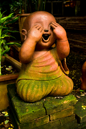 symbolic: Chiang Mai Thailand, August,29-2015: one of children clay staue in symbolic acting on  buddhism belief.