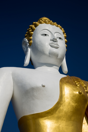 temple: ChiangMai, Thailand, November 01-2015: Buddha image located up to the hill at Wat PraThat DoiKam.