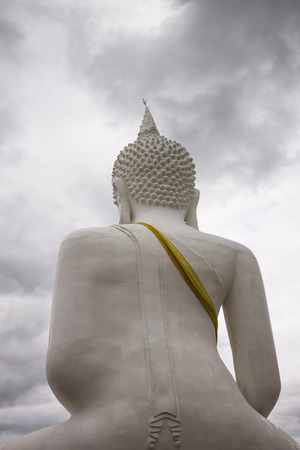 buddha image: ChiangMai, Thailand. June, 08-2016: The back of Buddha image situated in front of cloudy sky. Stock Photo