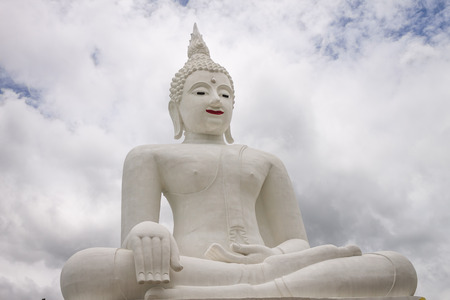 buddha image: ChiangMai, Thailand. June, 08-2016: The Buddha image situated in front of cloudy sky. Stock Photo