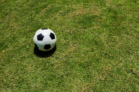 has been: A ball has been abandoned at the grass field. Stock Photo