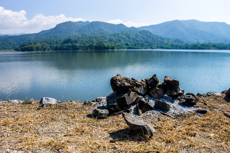 lack of water: ChiangMai, Thailand. December, 13-2016: An unknown Campfire was extinguished above on reserved water at Mae On irrigation dam. Stock Photo