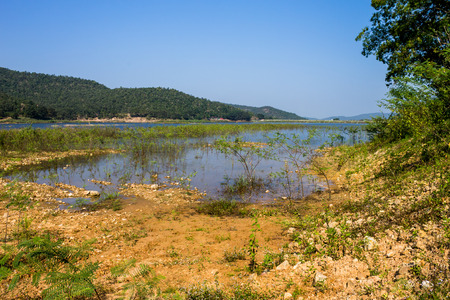 lack of water: ChiangMai, Thailand. December, 07-2016: The inadequacy of water reservoir was shown in its low level at the irrigation dam. Stock Photo
