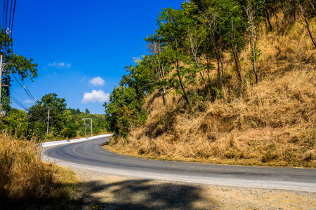 cleared: ChiangMai, Thailand. December, 13-2016: Serpentine road leads to the top of a mountain. Stock Photo