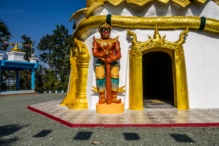 Thai traditional imaginary guardian was located in front of entry way for symbolize to protection from evils in Buddism beliefs. Stock Photo