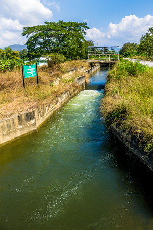 ChiangMai, Thailand. January, 19-2017: Irrigational canal situated in rural area due to water reservation for agricultural purposes.