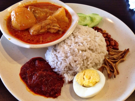 lemak: Malaysian famous local delicacies Nasi Lemak. The rice is cooked with coconut milk and the highlight of the dish is the sambal the red chilly gravy. Stock Photo