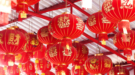 believes: Chinese red lamps on Temple's ceiling. related to beleives in Buddism. Stock Photo