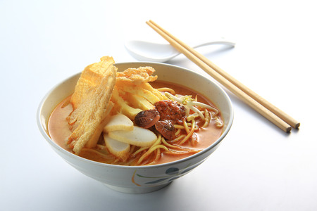 Malaysia favorite spicy noodle laksa with fish cake and cockle photo