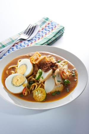 assam: Malaysia favorite spicy noodle mee rebus with fish cake egg Stock Photo