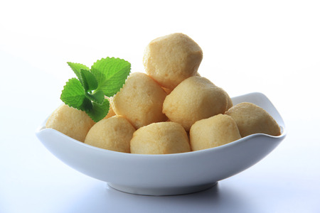 Dish of fish ball in golden color ornament peppermint leaf