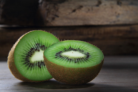 two and a half: Two slice of kiwi cut in half with a mood lighting