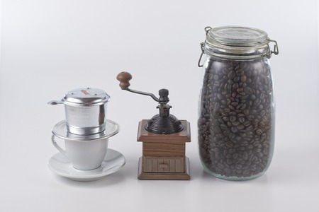 Vietnam style coffee and manual grinder and coffee bean in clean background