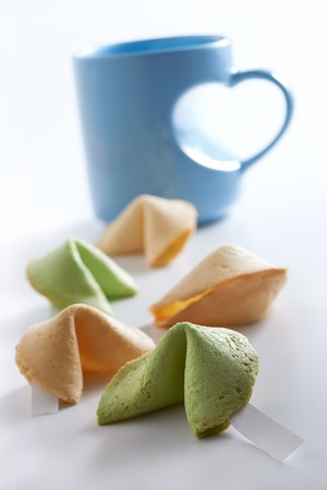 Fortune cookies with love shape cup on clean background