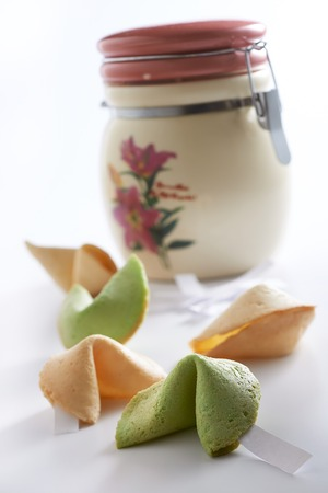 Fortune cookies with ceramic container in mood lighting Reklamní fotografie