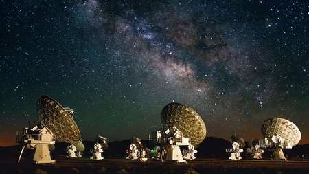 observatory: Radio telescopes silhouette with galaxy background