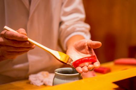 Sushi Chef is preparing Tuna Sushi
