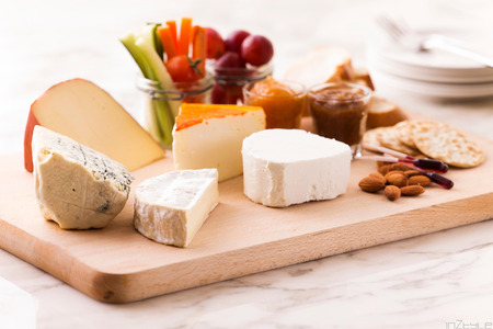 cheese platter: cheese platter with nuts and grapes