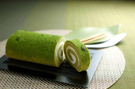 Sliced Green tea roll cake Stock Photo