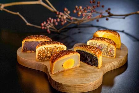 Six half cut mooncakes to show egg yolk Stock Photo