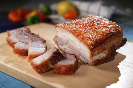 Oriental Roast Pork Belly on wooden chopping board