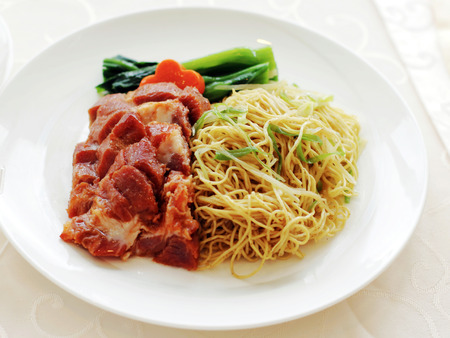 Traditional Chinese cruisine: BBQ pork noodle on white dish