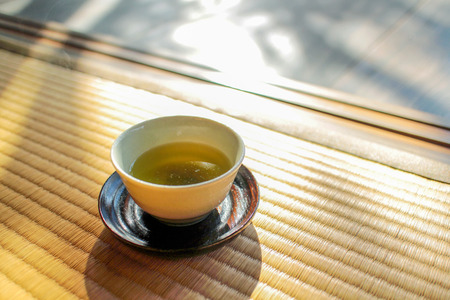 Afternoon tea spa day. A cup of green tea on a traditional Japanese mat, tatami